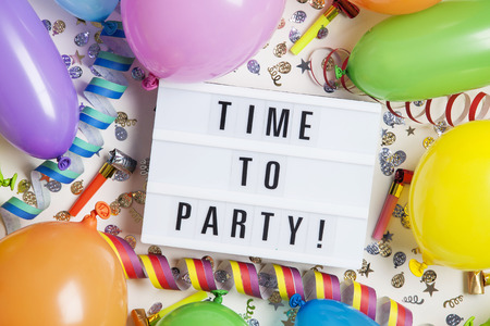 Party celebration background with time to party message on a lightbox