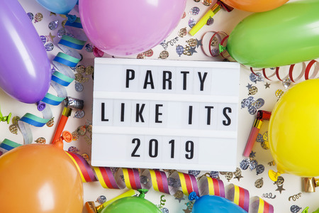 Party celebration background with party message on a lightbox Stock Photo