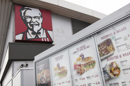 LONDON, UK - February 21st 2018: KFC fast food signage. KFC is an american fast food company that specializes in chicken