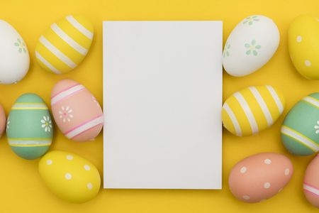 Easter holiday background. Pastel coloured decorated easter eggs with a blank white label.