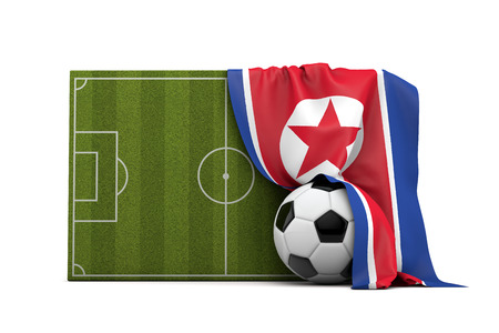 North Korea country flag draped over a football soccer pitch and ball. 3D Rendering