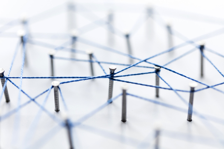 A large grid of pins connected with string. Communication, technology, network concept Stock Photo