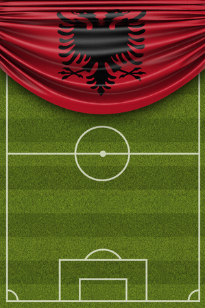 Albania country flag draped over a football soccer pitch. 3D Rendering