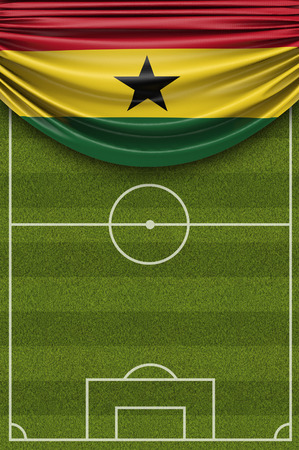 Ghana country flag draped over a football soccer pitch. 3D Rendering 写真素材