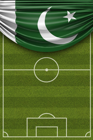 Pakistan country flag draped over a football soccer pitch. 3D Rendering