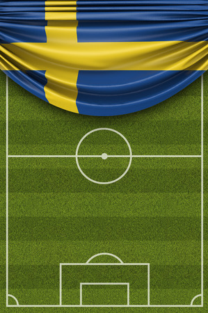 Sweden country flag draped over a football soccer pitch. 3D Rendering