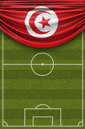 Tunisia country flag draped over a football soccer pitch. 3D Rendering 写真素材