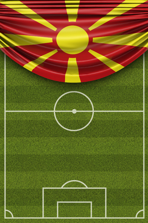 Macedonia country flag draped over a football soccer pitch. 3D Rendering 写真素材