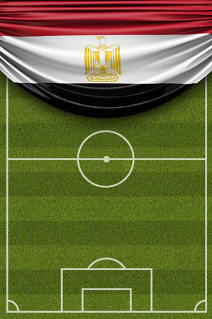 Egypt country flag draped over a football soccer pitch. 3D Rendering 写真素材