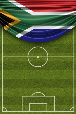 South Africa country flag draped over a football soccer pitch. 3D Rendering