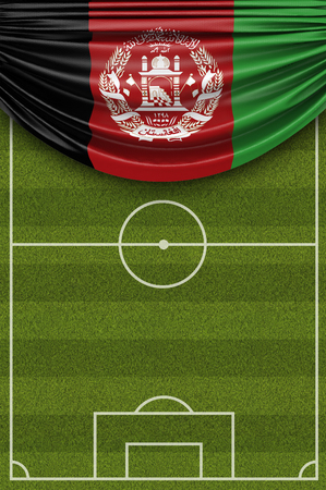 Afghanistan country flag draped over a football soccer pitch. 3D Rendering Stock Photo - 97862348