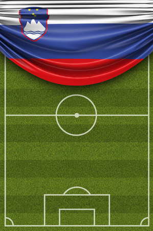 Slovenia country flag draped over a football soccer pitch. 3D Rendering