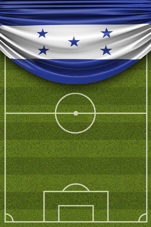 Honduras country flag draped over a football soccer pitch. 3D Rendering 写真素材