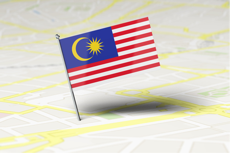 Malaysia national flag location pin stuck into a city road map. 3D Rendering