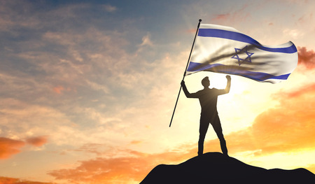 Israel flag being waved by a man celebrating success at the top of a mountain. 3D Rendering