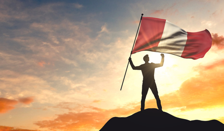 Peru flag being waved by a man celebrating success at the top of a mountain. 3D Rendering