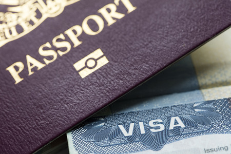 Close up of a Visa document and passport. Immigration and emigration concept Stok Fotoğraf - 99804758