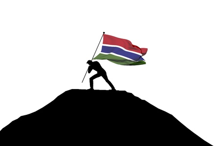 Gambia flag being pushed into mountain top by a male silhouette. 3D Rendering Stock Photo