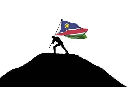 Namibia flag being pushed into mountain top by a male silhouette. 3D Rendering Stock Photo