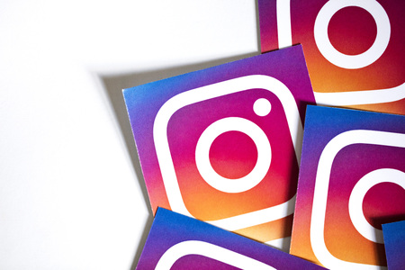 OXFORD, UK - NOVEMBER 17th 2016: A collection of Instagram logos printed onto paper. Instagram is a popular social media application for sharing images and videos