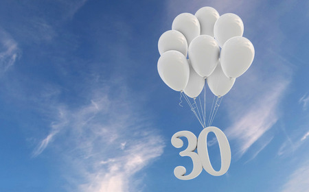 Number 30 party celebration. Number attached to a bunch of white balloons against blue sky