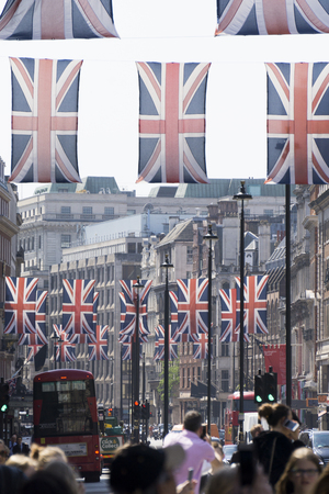 LONDON, UK - MAY 16th 2018: Union Jack flags hang in Regent Street, Central London in preperation for the royal wedding of Prince Harry and Meghan Markle Editorial