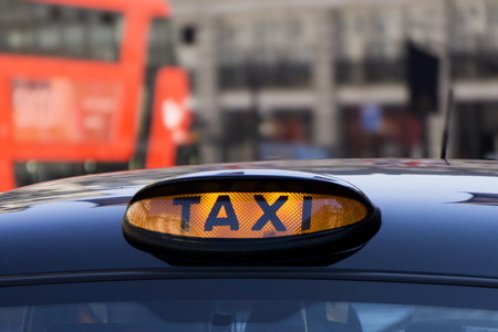 Cloce up of an illuminated taxi sign Archivio Fotografico