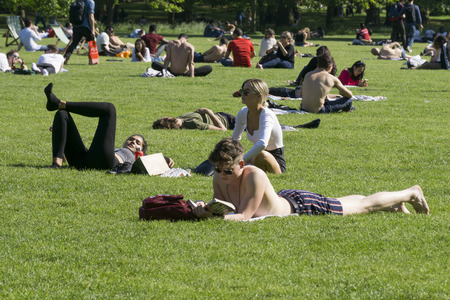 LONDON, UK - MAY 15th 2018: People enjoy the hot sunny weather in Central London by relaxing in the parks Editorial