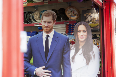WINDSOR, UK - MAY 17th 2018: Cutout of Prince Harry and Meghan Markle in a shop in Windsor befor the Royal Wedding