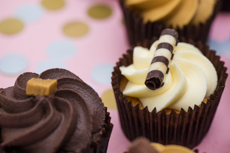 Cupcakes decorated with chocolate,caramel and vanilla icing Stock Photo