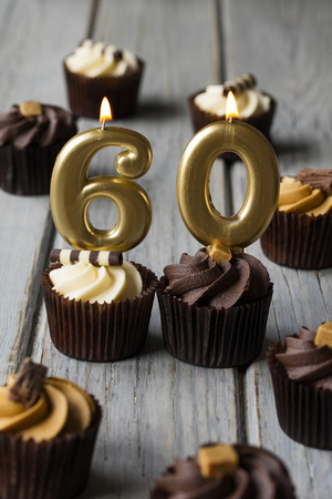 Number 60 celebration birthday cupcakes on a wooden background Stock Photo