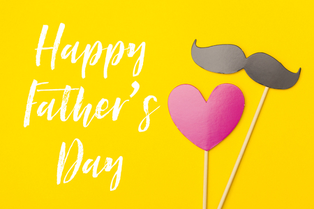 Fathers day greeting card message with mustache on a yellow stock fathers day greeting card message with mustache on a yellow background stock photo 102599963 m4hsunfo
