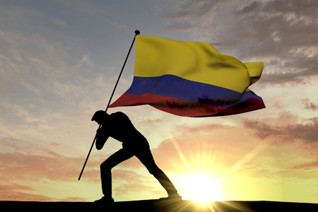 Colombia flag being pushed into the ground by a male silhouette. 3D Rendering