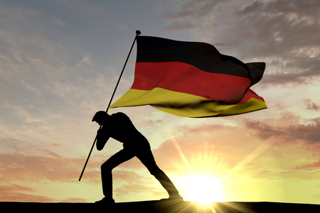 Germany flag being pushed into the ground by a male silhouette. 3D Rendering 스톡 콘텐츠 - 102813920