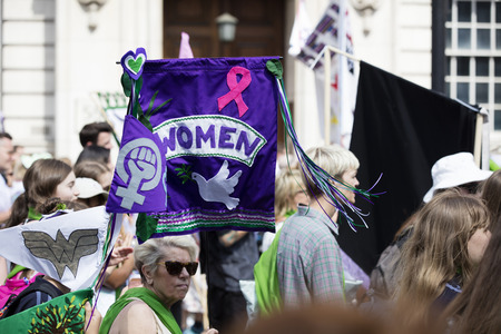 LONDON, UK - JUNE 10th 2018: Thousands of woman and girls march in London celebrating 100 years of the womens vote and gender equality, organised by 14-18 Now and artichoke. Editorial