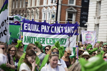 LONDON, UK - JUNE 10th 2018: Thousands of woman and girls march in London celebrating 100 years of the women's vote and gender equality, organised by 14-18 Now and artichoke. Stock Photo - 104327293