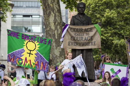 LONDON, UK - JUNE 10th 2018: Thousands of woman and girls march in London celebrating 100 years of the women's vote and gender equality, organised by 14-18 Now and artichoke. Stock Photo - 104327313