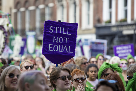 LONDON, UK - JUNE 10th 2018: Thousands of woman and girls march in London celebrating 100 years of the womens vote and gender equality, organised by 14-18 Now and artichoke. Redactioneel