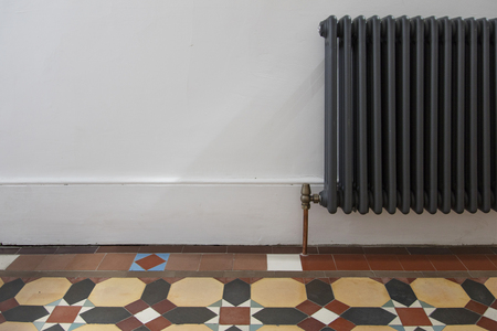 House entrance hall with period feature victorian tiles and radiator