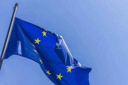 European union flag flying against a blue sky background