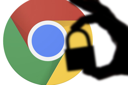 LONDON, UK - JULY 6th 2018: Google Chrome security issues. Silhouette of a hand holding a padlock infront of the google chrome logo 에디토리얼
