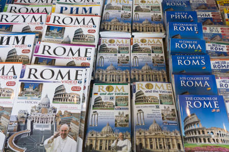ROME, ITALY - JUNE 16th 2018: Tourist travel guide books for Rome on sale at a market