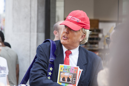 LONDON, UK - July 14th 2018: A Donald Trump lookalike poses in the street during an Anti Trump protest in central London
