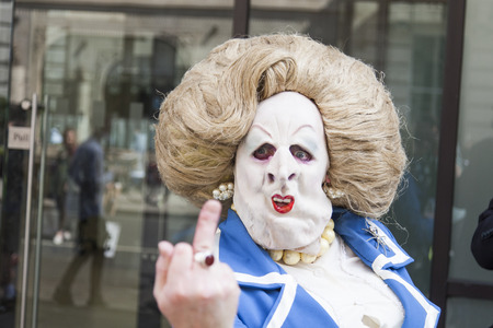 LONDON, UK - July 14th 2018: A person dressed as Margaret Thatcher poses in the street during a protest in central London