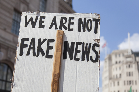 We are not fake news political banner at a protest march Stok Fotoğraf