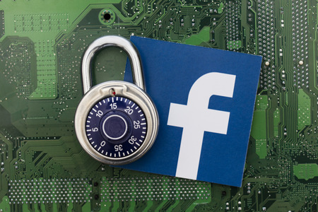 LONDON, UK - AUGUST 8th 2018: Facebook data security concept. A combination padlock with the facebook social media logo
