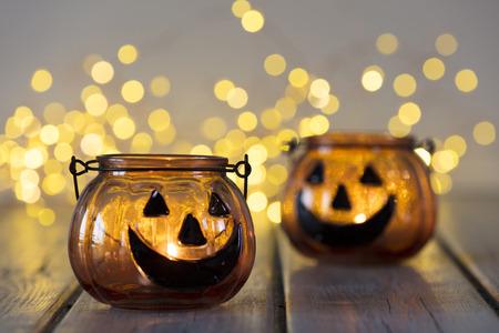 Halloween pumpkin lantern with bokeh fairy lights background Stock Photo