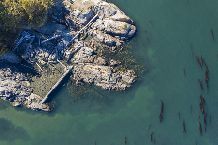 Aerial view of a rocky coatline with claer ocean on Vancouver Island, Canada