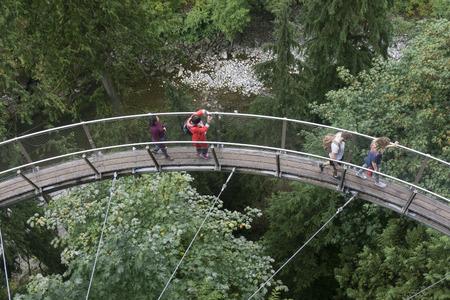 VANCOUVER, CANADA - SEPTEMBER 11th 2018: Visitors on the cliffwalk bridge at Capilano suspension bridge park in North Vancouver