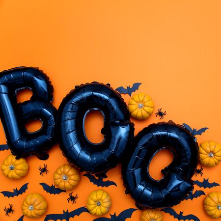 Halloween balloon word boo with pumpkins and bats